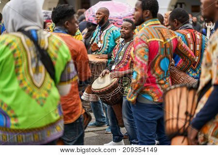 MOSCOW RUSSIA 14 OCTOBER 2017: Carnival parade in Moscow dedicated to the 19th World Festival of Youth and Students. African musicians play drums