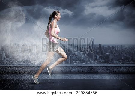 Profile view of sportswoman running on a white background against white dust powder