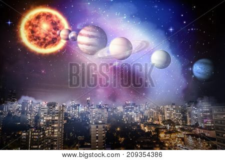 Composite image of planets and sun against illuminated city at night in 3d