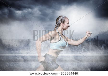 Side view of female athlete running against splashing of color powder