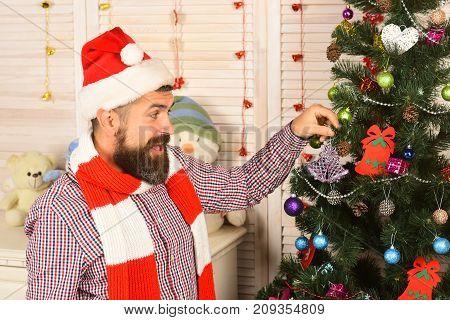 Man With Beard Holds Purple Tree Decoration.
