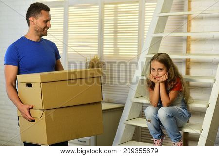 Daughter And Father Hold Boxes And Unpack Or Pack.