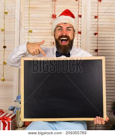 Man With Beard And Bow Tie Holds Blank Blackboard