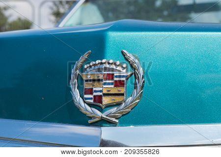 Vintage Cadillac Logo Or Emblem On Green Background