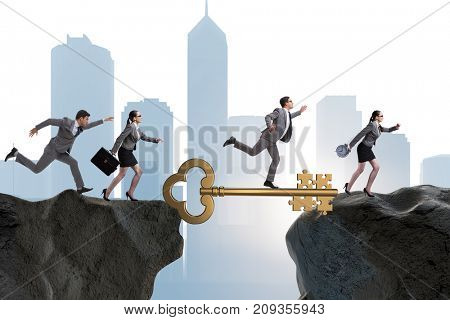 Business people chasing each other towards key to success