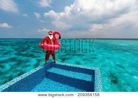 Christmas Santa Claus at tropical ocean luxury resort