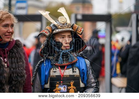 MOSCOW RUSSIA 14 OCTOBER 2017: Carnival parade in Moscow dedicated to the 19th World Festival of Youth and Students. Samurai armour and helmet. Carnival costumes. Soldiers on outside