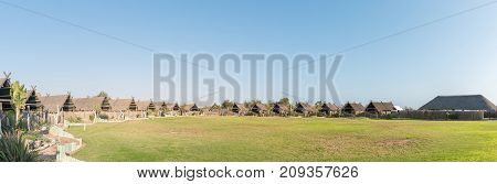 SWAKOPMUND NAMIBIA - JUNE 29 2017: Panorama of Tiger Reef Rest Camp in Swakopmund in the Namib Desert on the Atlantic Coast of Namibia. Each roofed structure is a camping site