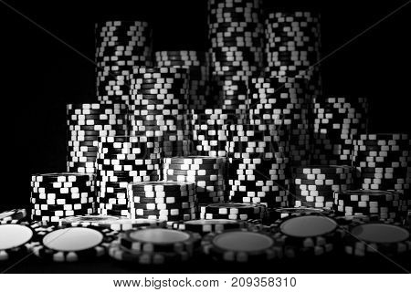 Stack of Poker chips on a green gaming poker table at the casino. Poker game concept. Playing a game with dice. Casino Concept for business risk chance good luck or gambling. chips for poker game. Black and white