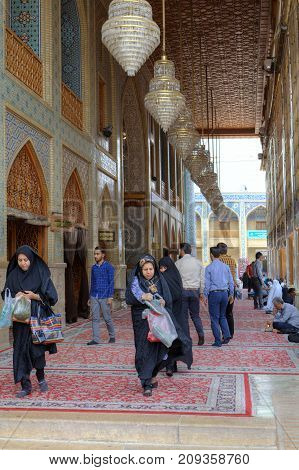 Fars Province Shiraz Iran - 19 april 2017: Shah Cheragh Shrine Iranian people visit the mosque at the prayer hour.