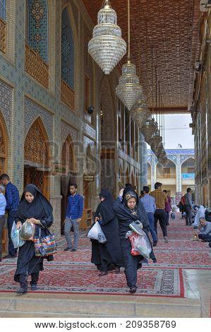 Fars Province Shiraz Iran - 19 april 2017: Shah Cheragh Shrine Iranian parishioners at the entrance to the mosque.