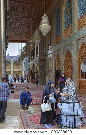 Fars Province Shiraz Iran - 19 april 2017: Shah Cheragh Shrine Iranian women took off their shoes before entering the mosque.