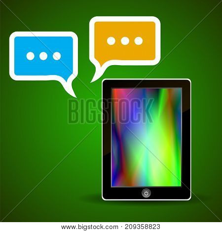 tablet computer and speech bubbles isolated on green background