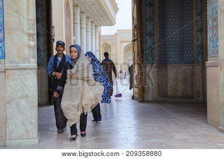 Fars Province Shiraz Iran - 19 april 2017: Shah Cheragh Shrine Muslim parishioners pass through the large gate of mosque Iran.