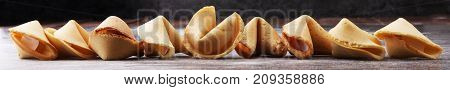 Fortune Cookies on dark background. Chinese cookie with wisdom.