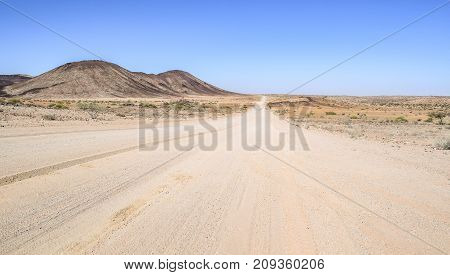 abandoned area with dusty dirt road in Namibia Africa