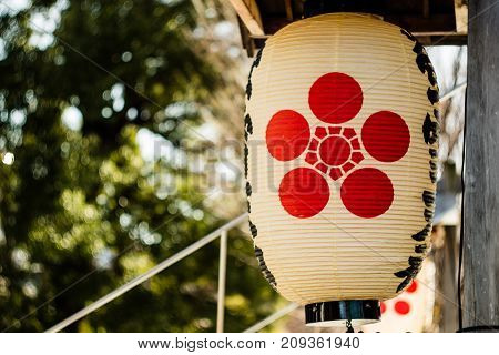 A Japanese lantern hanging outside a Shinto Shrine in Japan.