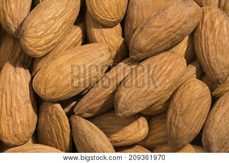Closeup View And Pattern Of Some Almonds.