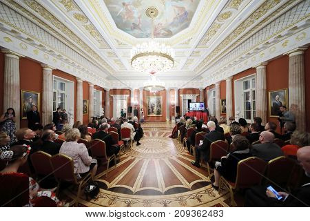 MOSCOW - SEP 16, 2017: People sit in hall during Great Catherine Ball (dance party) in Tsaritsyno