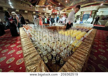 MOSCOW - JUN 8, 2017: Waiter with wine glasses at Award Records of real estate market 2017 in Golden Palace
