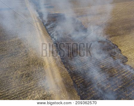 Aerial view of fire on crop field