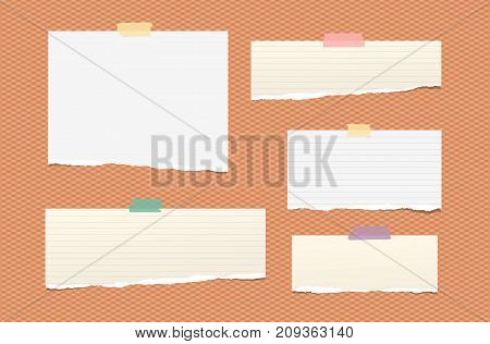 White and brown ripped lined paper strips, notebook, note for text or message stuck with colorful sticky tape on orange squared background
