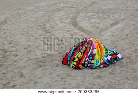 Towels Abounding On The Beach By An Abusive Seller After Police