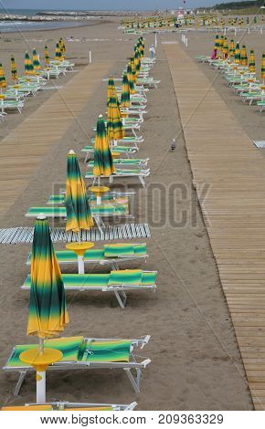 Beach With A Series Of Sunshades And Deckchairs
