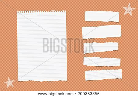 White ripped lined paper strips, sheet, notebook, note for text or message stuck tape on orange squared background