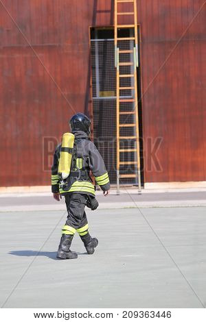 Firefighter With The Oxygen Cylinder