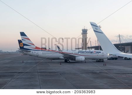 Lod Israel October 04 2017 : Airplanes of several aviation companies stand in the early morning at the terminal building at the international Ben Gurion airport near the city of Lod in Israel.