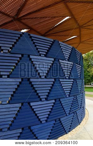 A decorative wooden structure in a park in London