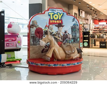 Bucharest Romania October 04 2017 : Electric swing in the form of a horse in the central hall of a shopping center in Bucharest Romania.