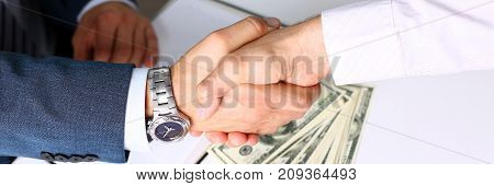 Man in suit shake hand as hello in office closeup. Friend welcome, mediation offer, positive introduction, greet or thanks gesture, summit participate approval, motivation, strike arm bargain concept
