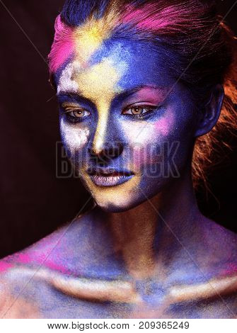 beauty woman with creative make up like Holy celebration in India closeup, colored print on face