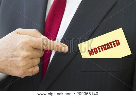 Businessman showing a card with text MOTIVATED.