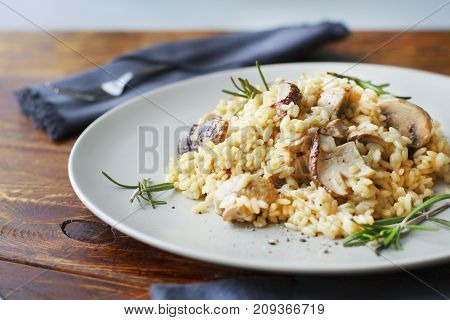 delicious rice with mushrooms and green rosemary, risotto