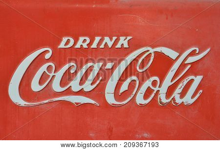 New Mexico Usa - July 21 2017: Sign of Coca-Cola painted in a rusty and old metal. Coca-Cola is a carbonated soft drink produced by The Coca-Cola Company.