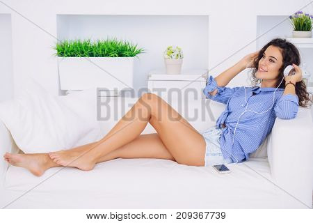 Happy young woman enjoys her life and using smartphone.