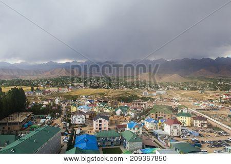 a village in Kyrgyzstan a sandstorm cloudy