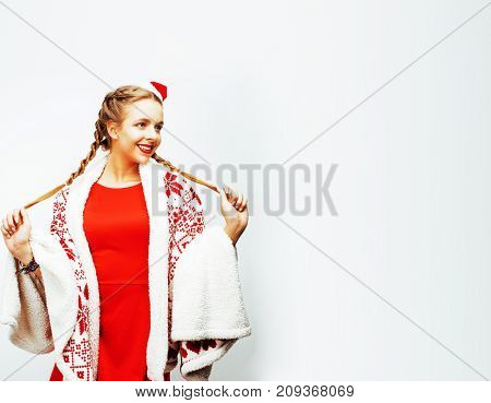 young pretty happy smiling blond woman on christmas in santas red hat and holiday decorated plaid, lifestyle people concept close up