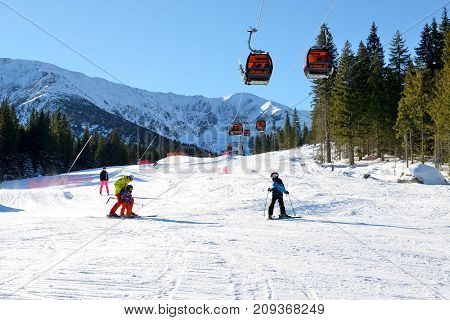 JASNA SLOVAKIA - JANUARY 22: The snowpark skiers and cableway in Jasna Low Tatras. It is the largest ski resort in Slovakia with 49 km of pistes on January 22 2017 in Jasna Slovakia