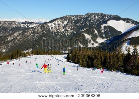 JASNA SLOVAKIA - JANUARY 22: The skiers and snowborders are on in Jasna Low Tatras. It is the largest ski resort in Slovakia with 49 km of pistes on January 22 2017 in Jasna Slovakia