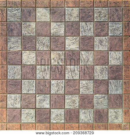Chessboard made of stone tiles as background
