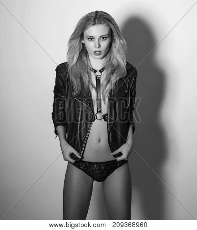 Sexy girl in black leather clothing monochrome shot