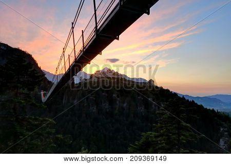 REUTTE AUSTRIA 14 June 2017 - The Highline 179 Tibetan-style suspension bridge and the ruins of Schlosskopf Fortress above Reutte Austria.