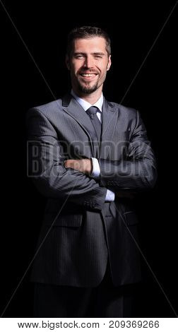 Close  up portrait of a business man on black background