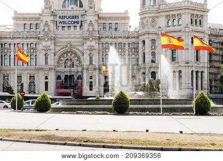 MADRID, SPAIN - April 20, 2017: Spanish flag, street view of downtown Madrid