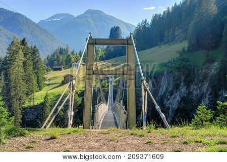 HOLZGAU AUSTRIA 18 June 2017 - Austria's longest (200m) pedestrian suspension bridge that opened in 2012 over Hoehenbach Canyon and connects Gfoellberg and Schiggenberg in Holzgau Austria.