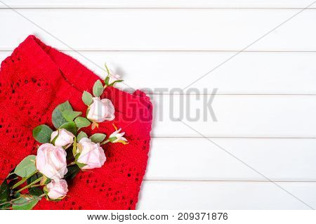 Red sweater on a white wooden background